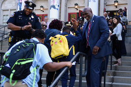 Superintendent Gregg high fives students