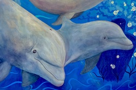 colorful mural of dolphins swimming